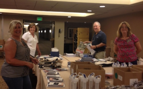 Cheryl Guyatt, Diane Nagle, David Stolls and Debra Martin stuffing registration bags